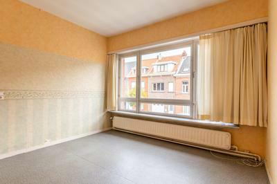 Goed onderhouden eengezinswoning met 3 slpk, gelegen vlakbij het centrum van Wijnegem.